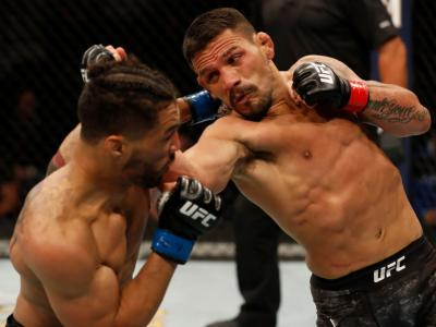 ROCHESTER, NY - MAY 18: (R-L) Rafael Dos Anjos of Brazil punches Kevin Lee in their welterweight bout during the UFC Fight Night