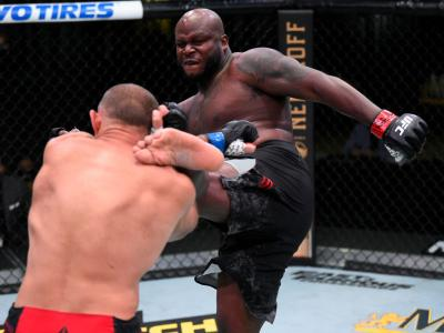LAS VEGAS, NEVADA - AUGUST 08: In this handout photo provided by UFC, (R-L) Derrick Lewis kicks Aleksei Oleinik of Russia in their heavyweight fight during the UFC Fight Night