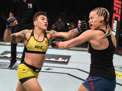 ABU DHABI, UNITED ARAB EMIRATES - OCTOBER 18: (L-R) Jessica Andrade of Brazil punches Katlyn Chookagian in their women's flyweight bout