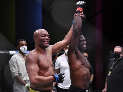 LAS VEGAS, NEVADA - OCTOBER 31: (L-R) Anderson Silva of Brazil raises the arm of his opponent Uriah Hall of Jamaica after their middleweight bout