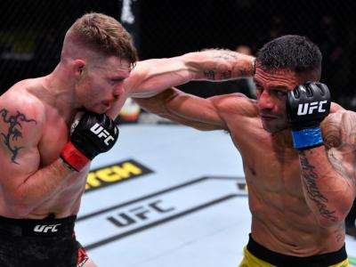 LAS VEGAS, NEVADA - NOVEMBER 14: (L-R) Paul Felder and Rafael Dos Anjos of Brazil trade punches in a lightweight fight during the UFC Fight Night