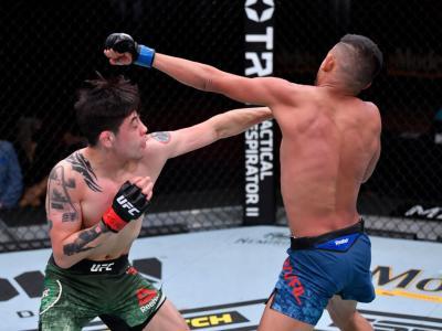 LAS VEGAS, NEVADA - NOVEMBER 21: (L-R) Brandon Moreno of Mexico punches Brandon Royval in their flyweight bout