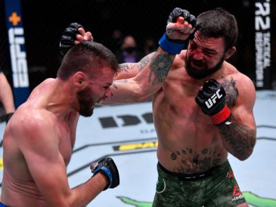 LAS VEGAS, NEVADA - NOVEMBER 21: (L-R) Tim Means and Mike Perry exchange punches in their welterweight bout during the UFC 255 e