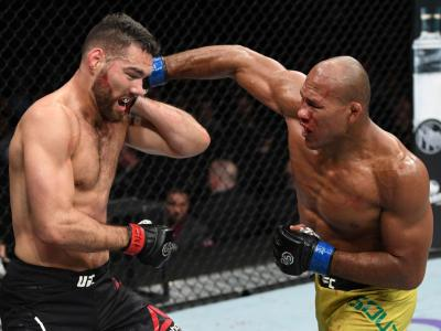 NEW YORK, NY - NOVEMBER 03: (R-L) Ronaldo Souza of Brazil punches Chris Weidman in their middleweight bout during the UFC 230