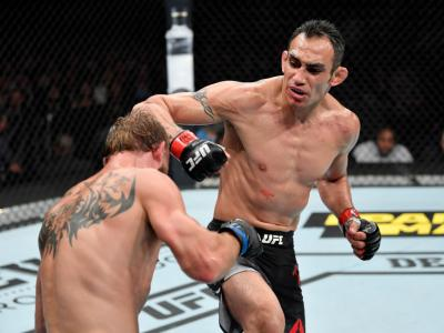 CHICAGO, IL - JUNE 08: (R-L) Tony Ferguson punches Donald Cerrone in their lightweight bout during the UFC 238 event at the United Center