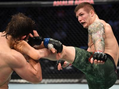 TAMPA, FLORIDA - OCTOBER 12: (R-L) Marvin Vettori of Italy kicks Andrew Sanchez in their middleweight bout during the UFC Fight Night