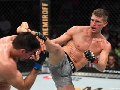 NEW YORK, NEW YORK - NOVEMBER 02: (R-L) Stephen Thompson kicks Vicente Luque of Brazil in their welterweight bout during the UFC 244 event at Madison Square Garden on November 02, 2019 in New York City. (Photo by Josh Hedges/Zuffa LLC)