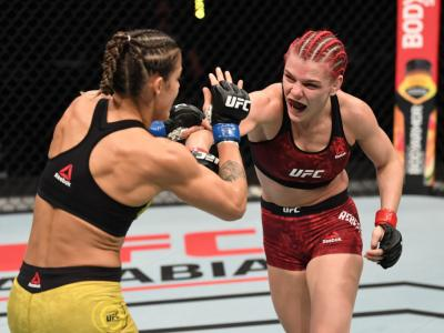ABU DHABI, UNITED ARAB EMIRATES - OCTOBER 18: (R-L) Gillian Robertson punches Poliana Botelho of Brazil in their women's flyweight bout