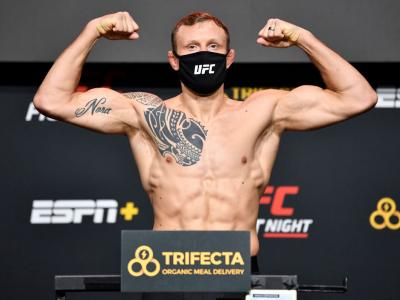 Jack Hermansson of Sweden poses on the scale during the UFC Fight Night weigh-in at UFC APEX