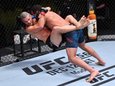 LAS VEGAS, NEVADA - DECEMBER 05: (R-L) Jordan Leavitt slams Matt Wiman in a lightweight bout during the UFC Fight Night