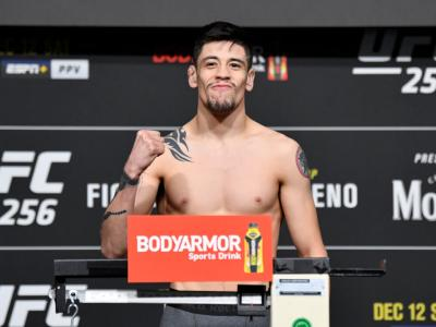 LAS VEGAS, NEVADA - DECEMBER 11: Brandon Moreno of Mexico poses on the scale during the UFC 256 weigh-in at UFC APEX