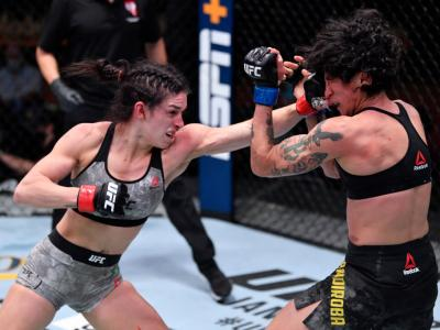 LAS VEGAS, NEVADA - DECEMBER 12: (L-R) Mackenzie Dern punches Virna Jandiroba of Brazil in their women's strawweight bout during the UFC 256