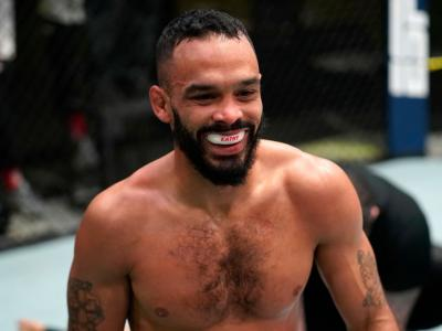 LAS VEGAS, NEVADA - DECEMBER 19: Rob Font celebrates after his victory over Marlon Moraes of Brazil in a bantamweight fight during the UFC Fight Night