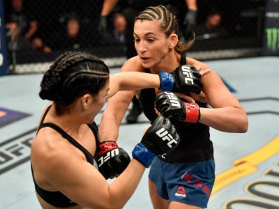 LAS VEGAS, NV - JULY 06: (R-L) Montana De La Rosa punches Rachael Ostovich in their women's flyweight bout during The Ultimate Fighter Finale