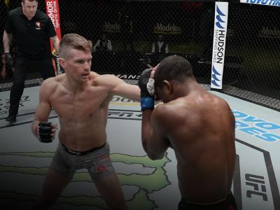 Stephen Thompson punches Geoff Neal in a welterweight fight during the UFC Fight Night event at UFC APEX on December 19, 2020 in Las Vegas, Nevada. (Photo by Cooper Neill/Zuffa LLC)