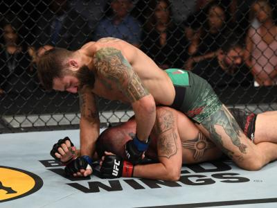 LAS VEGAS, NV - JULY 06: Michael Chiesa punches Diego Sanchez in their welterweight fight during the UFC 239
