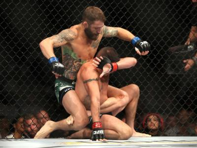 LAS VEGAS, NEVADA - JULY 06: Diego Sanchez of the United States botom is punched by Michael Chiesa of the United States during their UFC 239