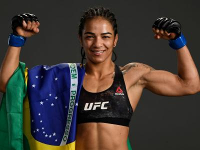 EDMONTON, ALBERTA - JULY 27: Viviane Araujo of Brazil poses for a portrait backstage after her victory over Alexis Davis during the UFC 240