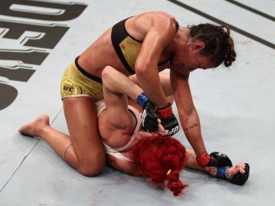 UFC Fight Night: Ribas v Markos BRASILIA, BRAZIL - MARCH 14: (L-R) Amanda Ribas of Brazil punches Randa Markos of Canada in their strawweight fight during the UFC Fight Night