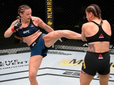 LAS VEGAS, NEVADA - AUGUST 01: (L-R) Joanne Calderwood of Scotland kicks Jennifer Maia of Brazil in their flyweight fight during the UFC Fight Night