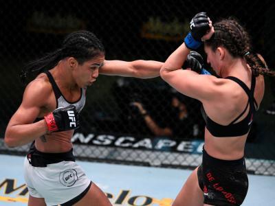 LAS VEGAS, NEVADA - SEPTEMBER 05: (L-R) Viviane Araujo of Brazil punches Montana De La Rosa in a flyweight fight during the UFC Fight Night