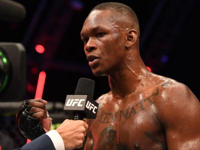 ABU DHABI, UNITED ARAB EMIRATES - SEPTEMBER 27: Israel Adesanya of Nigerian is interviewed after defeating Paulo Costa of Brazil in their middleweight championship bout during UFC 253