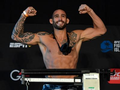 ABU DHABI, UNITED ARAB EMIRATES - JANUARY 15: Santiago Ponzinibbio of Argentina poses on the scale during the UFC weigh-in at Etihad Arena