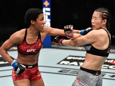ABU DHABI, UNITED ARAB EMIRATES - JANUARY 17: (L-R) Joselyne Edwards of Panama punches Wu Yanan of China in a bantamweight bout during the UFC Fight Night