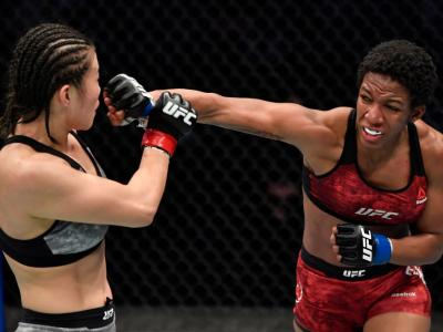 ABU DHABI, UNITED ARAB EMIRATES - JANUARY 17: (R-L) Joselyne Edwards of Panama punches Wu Yanan of China in a bantamweight bout during the UFC Fight Night