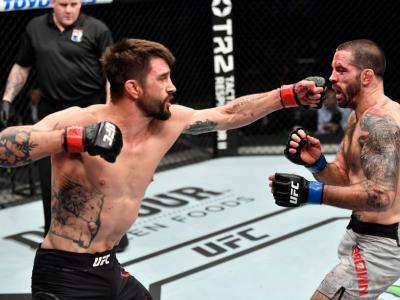 ABU DHABI, UNITED ARAB EMIRATES - JANUARY 17: (L-R) Carlos Condit punches Matt Brown in a welterweight bout during the UFC Fight Night event