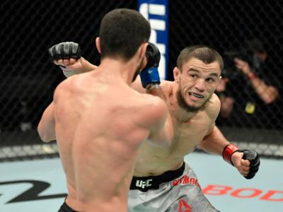 ABU DHABI, UNITED ARAB EMIRATES - JANUARY 20: (R-L) Umar Nurmagomedov of Russia punches Sergey Morozov of Kazakhstan in a bantamweight fight during the UFC Fight Night
