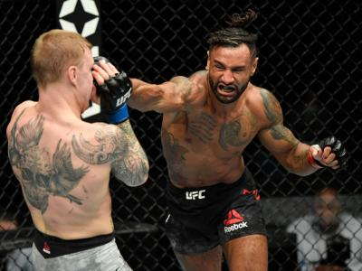 ABU DHABI, UNITED ARAB EMIRATES - JANUARY 20: (R-L) Mike Davis punches Mason Jones in a lightweight fight during the UFC Fight Night