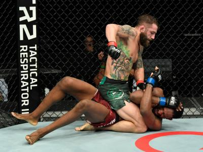 ABU DHABI, UNITED ARAB EMIRATES - JANUARY 20: (L-R) Michael Chiesa punches Neil Magny in a welterweight fight during the UFC Fight Night
