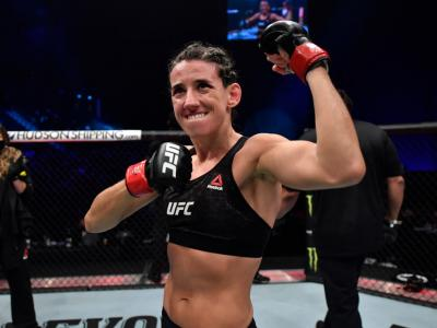 ABU DHABI, UNITED ARAB EMIRATES - JANUARY 23: Marina Rodriguez of Brazil reacts after her knockout victory over Amanda Ribas of Brazil in a strawweight fight during the UFC 257