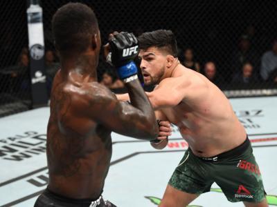ATLANTA, GEORGIA - APRIL 13: Kelvin Gastelum punches Israel Adesanya of Nigeria during the UFC 236 event at State Farm Arena