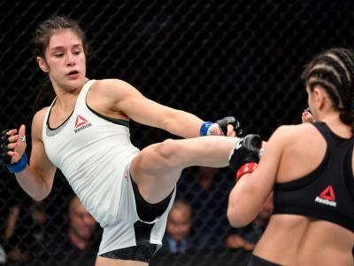 CHICAGO, IL - JUNE 08: (L-R) Alexa Grasso of Mexico kicks Karolina Kowalkiewicz of Poland in their women's strawweight bout during the UFC 238