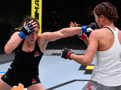 LAS VEGAS, NEVADA - AUGUST 29: In this handout image provided by UFC, (L-R) Alexa Grasso of Mexico punches Ji Yeon Kim of South Korea