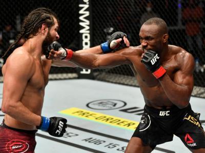 ABU DHABI, UNITED ARAB EMIRATES - JULY 12: (R-L) Kamaru Usman of Nigeria punches Jorge Masvidal in their UFC welterweight championship fight during the UFC 251
