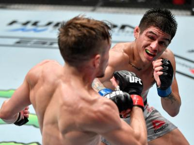 ABU DHABI, UNITED ARAB EMIRATES - JULY 26: In this handout image provided by UFC, (L-R) John Castaneda kicks Nathaniel Wood of England in their bantamweight fight