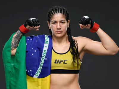 ABU DHABI, UNITED ARAB EMIRATES - SEPTEMBER 27: Ketlen Vieira of Brazil poses for a post fight portrait backstage during UFC 253