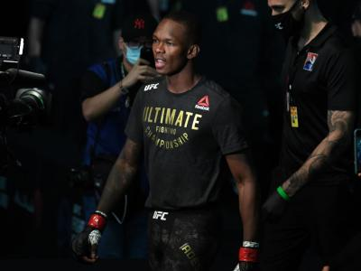 ABU DHABI, UNITED ARAB EMIRATES - SEPTEMBER 27: Israel Adesanya of Nigeria walks out towards the Octagon prior to facing Paulo Costa of Brazil in their middleweight championship bout during UFC 253