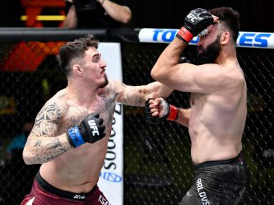 LAS VEGAS, NEVADA - FEBRUARY 20: (L-R) Tom Aspinall of England punches Andrei Arlovski of Belarus in a heavyweight bout during the UFC Fight Night