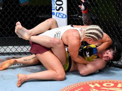 LAS VEGAS, NEVADA - FEBRUARY 20: (L-R) Yana Kunitskaya of Russia punches Ketlen Vieira of Brazil in a bantamweight bout during the UFC Fight Night