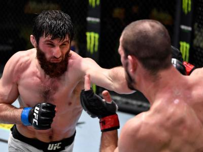 LAS VEGAS, NEVADA - FEBRUARY 27: (L-R) Magomed Ankalaev of Russia punches Nikita Krylov of the Ukraine in a light heavyweight bout during the UFC Fight Night