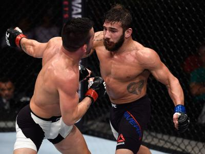 SAO PAULO, BRAZIL - NOVEMBER 07: Pedro Munhoz of Brazil punches Jimmie Rivera of the United States in their bantamweight bout during the UFC Fight Night