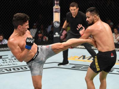 MINNEAPOLIS, MN - JUNE 29: (L-R) Joseph Benavidez kicks Jussier Formiga of Brazil in their flyweight bout during the UFC Fight Night