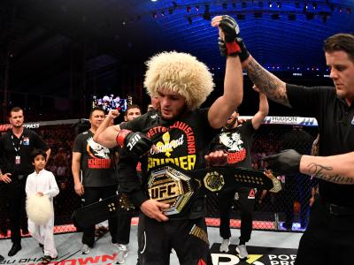 ABU DHABI, UNITED ARAB EMIRATES - SEPTEMBER 07: Khabib Nurmagomedov of Russia celebrates his submission victory over Dustin Poirier in their lightweight championship bout during UFC 242