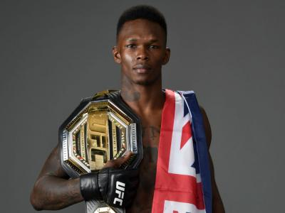 LAS VEGAS, NEVADA - MARCH 07: Israel Adesanya of Nigeria poses for a portrait backstage after his victory during the UFC 248