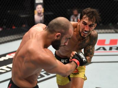 ABU DHABI, UNITED ARAB EMIRATES - OCTOBER 11: In this handout image provided by UFC, (R-L) Omar Morales of Venezuela punches Giga Chikadze of Georgia in their featherweight bout during the UFC Fight Night