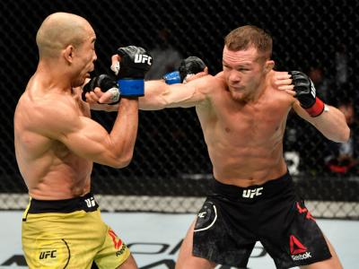 ABU DHABI, UNITED ARAB EMIRATES - JULY 12: (R-L) Petr Yan of Russia punches Jose Aldo of Brazil in their UFC bantamweight championship fight during the UFC 251